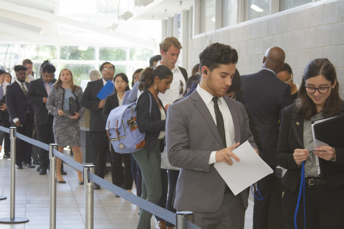 students wait in line at the career fair